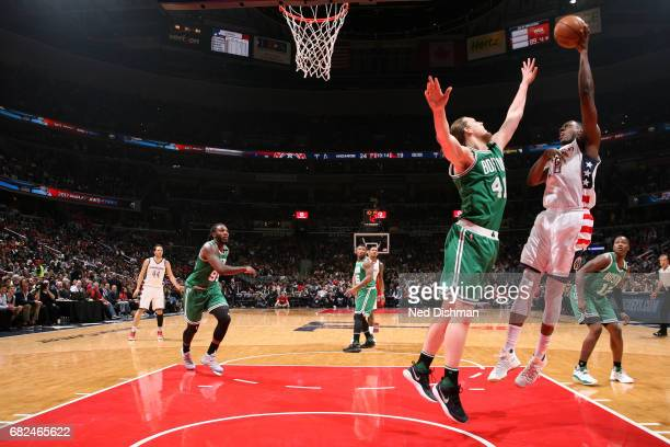 Ian Mahinmi of the Washington Wizards shoots the ball during the game against Kelly Olynyk of the Boston Celtics during Game Six of the Eastern...