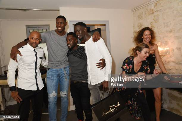 Ian Manhinmi Former French football player Ousmane Dabo and Designer Steeven Kodjia and team members pose during the French Deal Cocktail as part of...