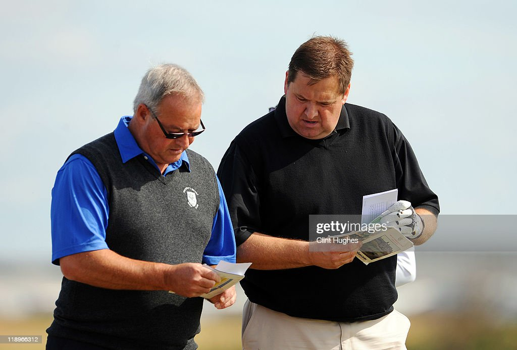 Ian Marshall (R) and Graham Daniels of Pontefract and District Golf Club check their score cards during the Virgin Atlantic PGA National Pro-Am Championship - Regional at St Annes Old Links Golf Club on July 13, 2011 in Lytham St Annes, England