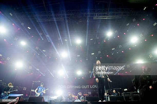 Ian Matthews Sergio PizzornoTom Meighan and Chris Edwards of Kasabian perform onstage at the King Power Stadium to Celebrate Leicester City's Premier...