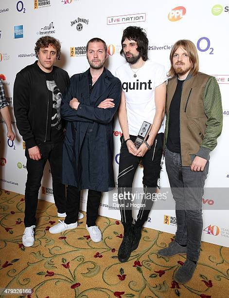 Ian Matthews Tom Meighan Sergio Pizzorno and Chris Edwards from Kasabian with their Best Band award at the Nordoff Robbins O2 Silver Clef awards at...