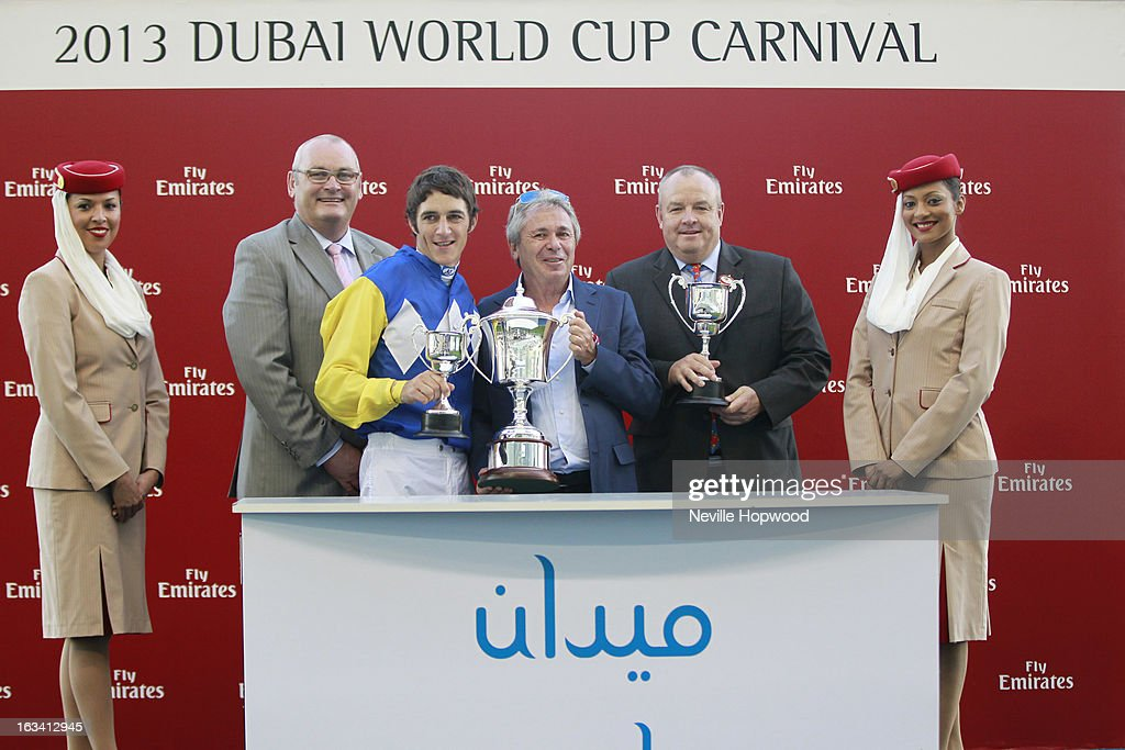 Ian McDougal (Regional Managaer of Emirates Commercial Operations), Jockey <a gi-track='captionPersonalityLinkClicked' href=/galleries/search?phrase=Christophe+Soumillon&family=editorial&specificpeople=453308 ng-click='$event.stopPropagation()'>Christophe Soumillon</a>, Owner Brian Joffe and trainer Mike De Kock attend the Meydan Sprint Presentation for Shea Shea's win in the 5f Meydan Sprint during Super Saturday at Meydan Racecourse on March 9, 2013 in Dubai, United Arab Emirates.