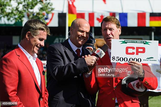 Ian Millar of Canada riding Dixson receives a cheque for $500000 after winning the individual jumping equestrian on the final day of the Masters...