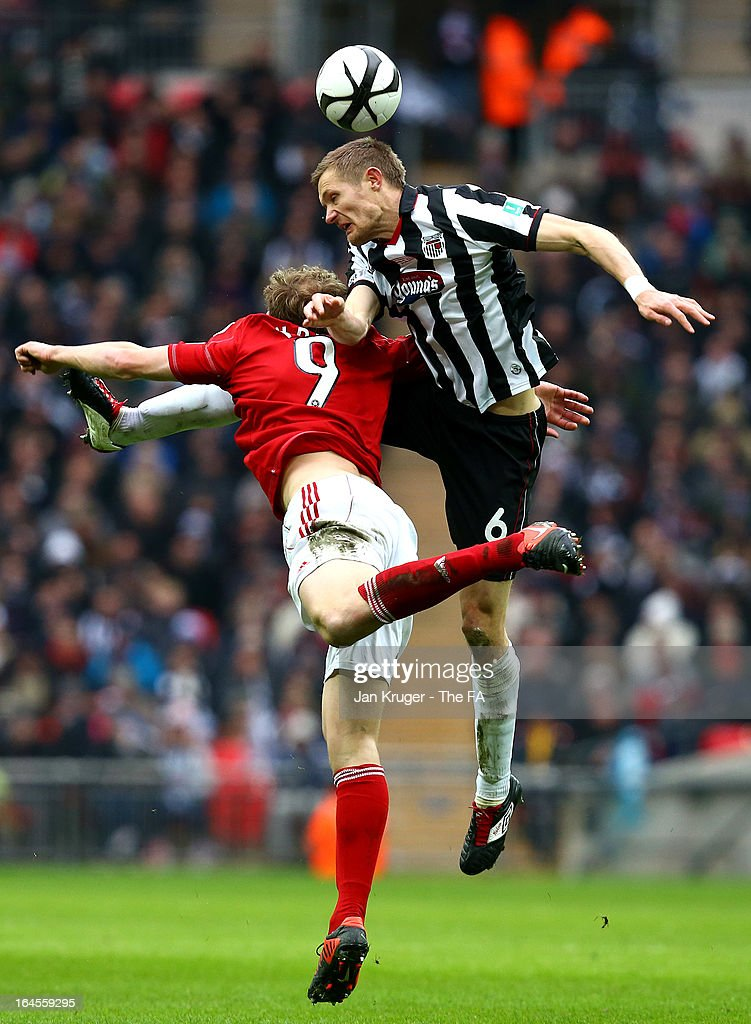 Ian Miller of Grimsby Town and Danny Wright Danny Wright competes for the arial ball during the FA Trophy Final between Wrexham and Grimsby Town at Wembley Stadium on March 24, 2013 in London, England.