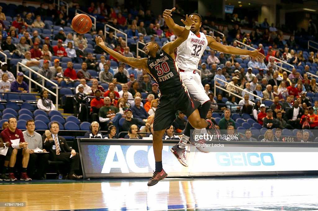Ian Miller of the Florida State Seminoles collides with Dez Wells of the Maryland Terrapins during the second round of the 2014 Men's ACC Basketball...