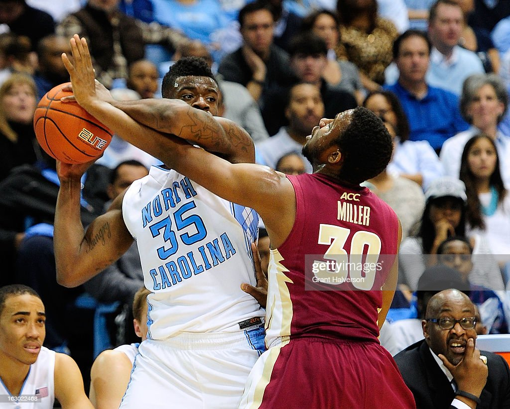 Ian Miller #30 of the Florida State Seminoles defends Reggie Bullock #35 of the North Carolina Tar Heels during play at Dean Smith Center on March 3, 2013 in Chapel Hill, North Carolina. North Carolina won 79-58.