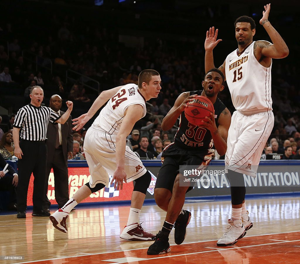 Ian Miller #30 of the Florida State Seminoles drives through Maurice Walker #15 and Joey King #24 of the Minnesota Golden Gophers during the NIT Championship semifinals at Madison Square Garden on April 1, 2014 in New York City.