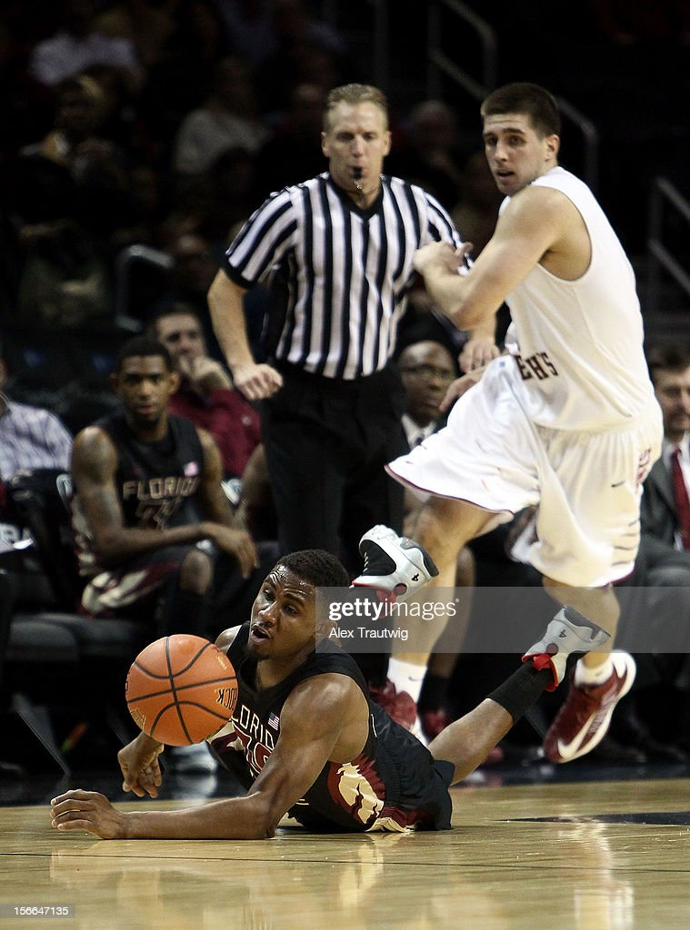 Ian Miller #30 of the Florida State Seminoles gets tripped up while going for a loose ball against Halil Kanacevic #21 of the Saint Joseph's Hawks during the championship game of the Coaches Vs. Cancer Classic at the Barclays Center on November 17, 2012 in the Brooklyn borough of New York City.