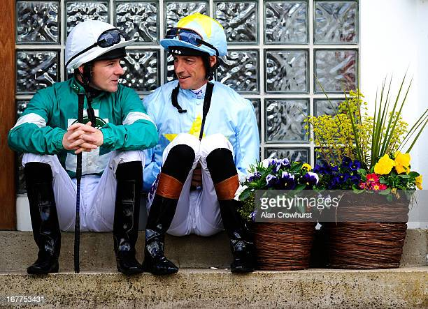 Ian Mongan and Richard Hughes chat before the first race at Windsor racecourse on April 29 2013 in Windsor England
