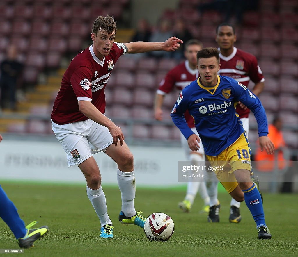 Ian Morris of Northampton Town looks to play the ball during the Sky Bet League Two match between Northampton Town and Morecambe at Sixfields Stadium on September 28, 2013 in Northampton, England.