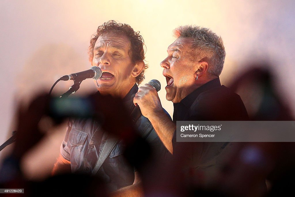 Ian Moss and Jimmy Barnes of Cold Chisel perform ahead of the 2015 NRL Grand Final match between the Brisbane Broncos and the North Queensland...