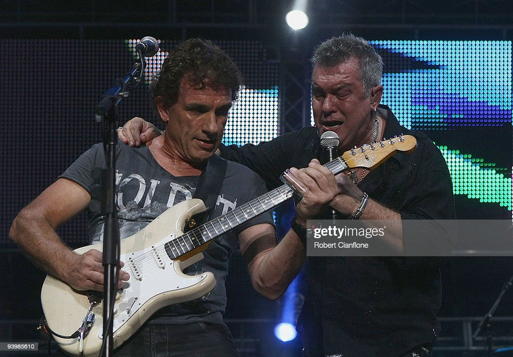 Ian Moss and Jimmy Barnes of Cold Chisel perform during a Cold Chisel concert at ANZ Stadium on December 5 2009 in Sydney Australia