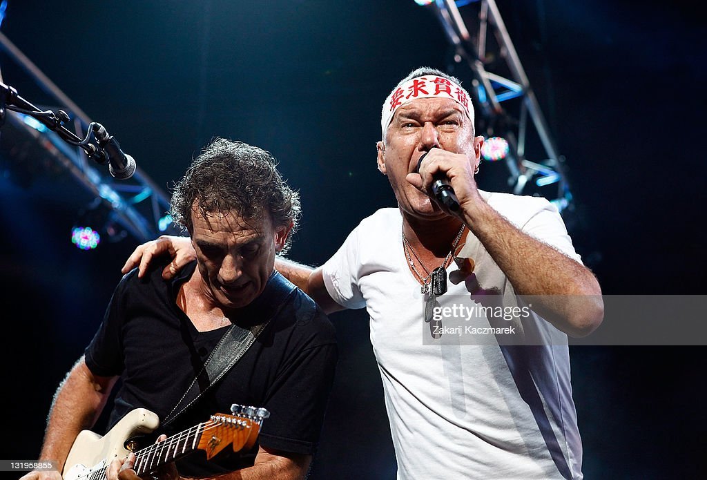 Ian Moss and Jimmy Barnes of Cold Chisel perform on stage at Allphones Arena on November 9 2011 in Sydney Australia