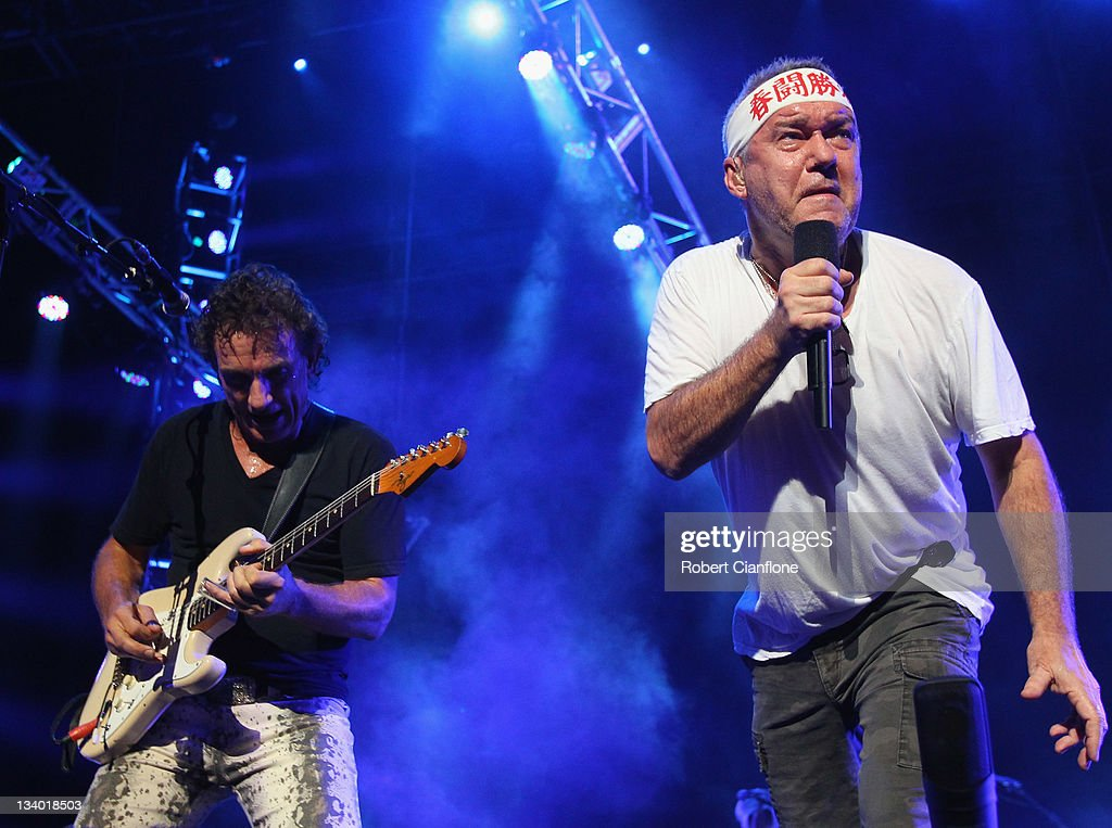 Ian Moss and Jimmy Barnes of Cold Chisel perform on stage at Rod Laver Arena on November 24 2011 in Melbourne Australia