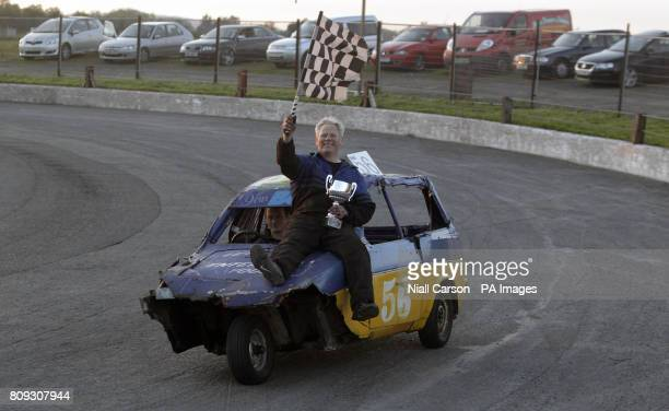 Ian 'Mr Entertainer' Bolton is given a victory lap after his win in the Reliant Robin race at the stock car racing event at Nutts Corner Raceway in...