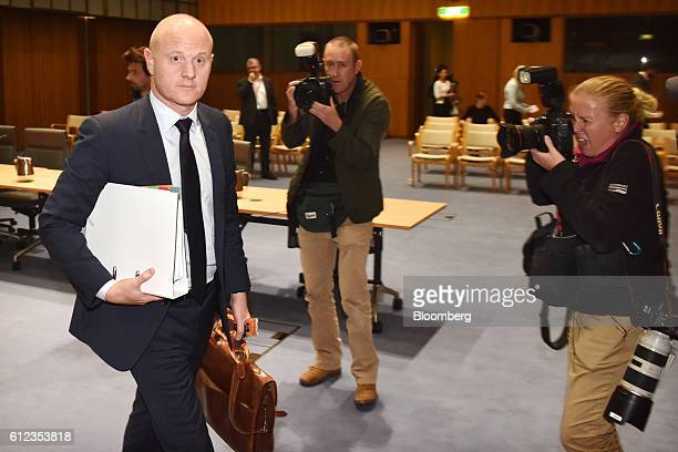 Ian Narev chief executive officer of Commonwealth Bank of Australia left departs a hearing before the House of Representatives Standing Committee on...