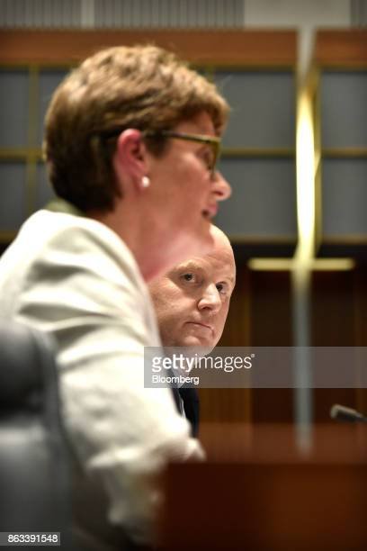 Ian Narev chief executive officer of Commonwealth Bank of Australia right looks on as Catherine Livingstone chairman speaks before the House of...