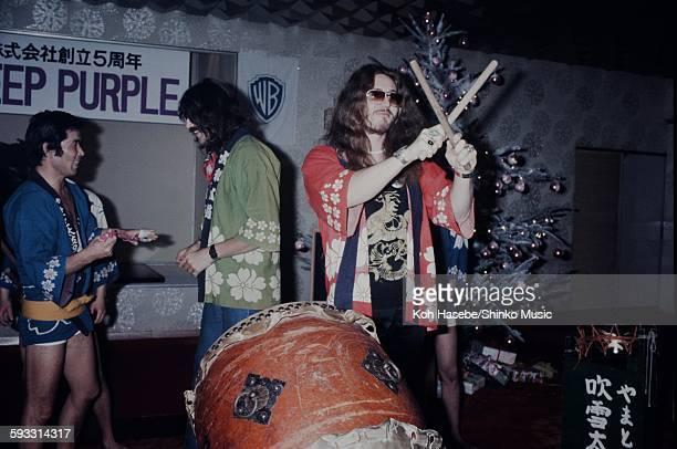 Ian Paice Deep Purple hitting big drum in happicoat at label sponsored reception Tokyo December 1975