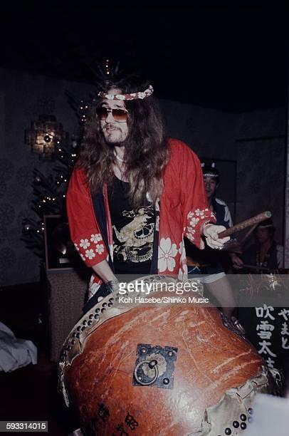 Ian Paice hitting big drum in happicoat at label sponsored reception Tokyo December 1975