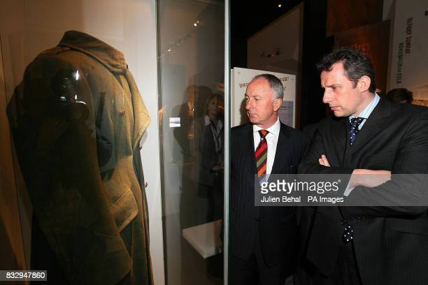 Ian Paisley Junior of the Democratic Unionist Party and Irish Minister for Foreign Affairs Dermot Ahern look at the overcoat worn by General Michael...