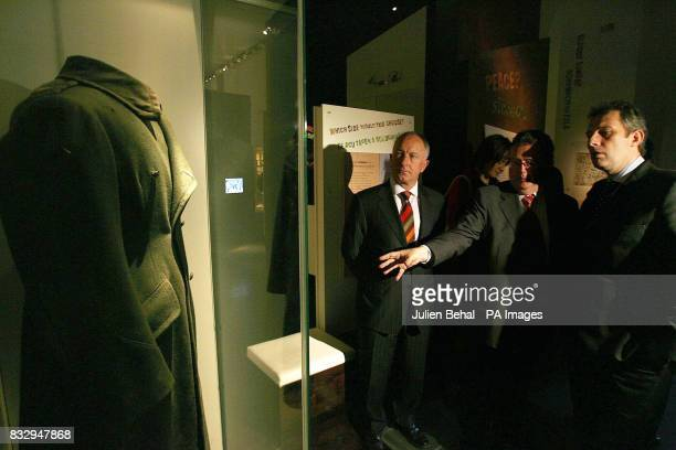 Ian Paisley Junior of the Democratic Unionist Party and Irish Minister for Foreign Affairs Dermot Ahern are shown an overcoat worn by General Michael...