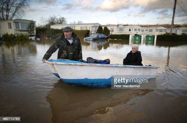 Ian Peacock Pulls A Boat Carrying Fellow Resident Caroline Hine As They Rescue Possesions From Flooded