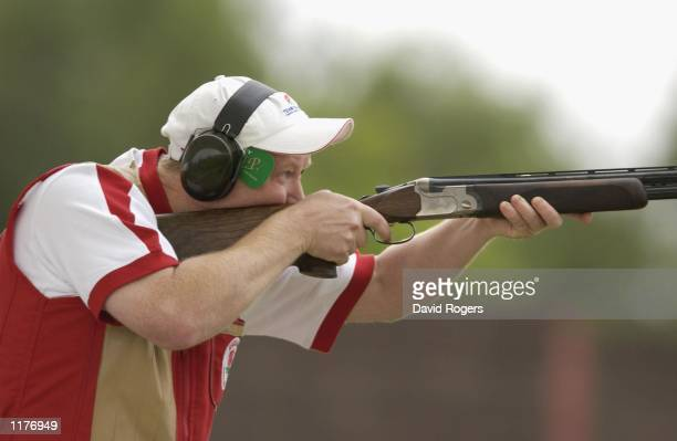 Ian Peel of England in action on his way to winning the silver medal in the Mens Trap Pairs event held in Bisley Surrey during the 2002 Commonwealth...