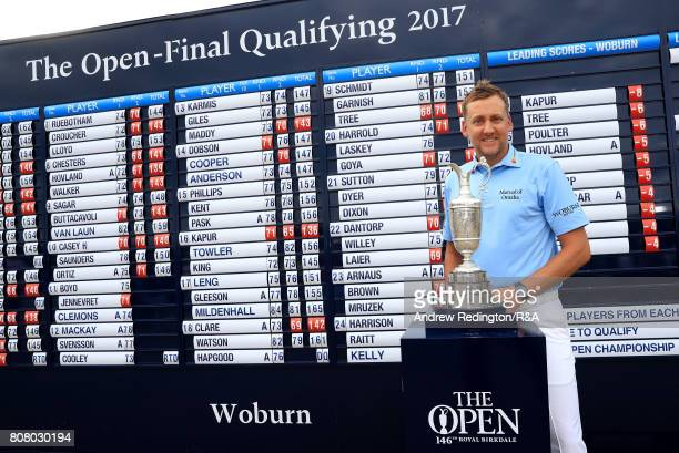 Ian Poilter of England poses next to the claret jug after securing one of the three qualifying positions during The Open Championship Final...