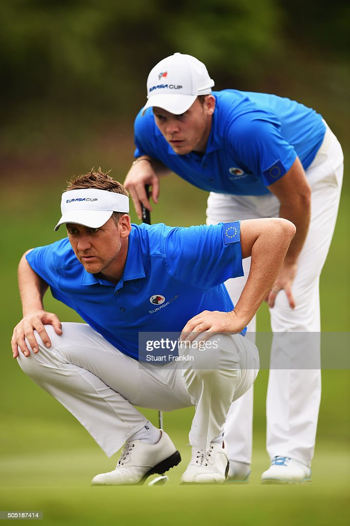 Ian Poulter and Danny Willett of team Europe line up a putt during thee second day's foursome matches at the EurAsia Cup presented by DRBHICOM at...