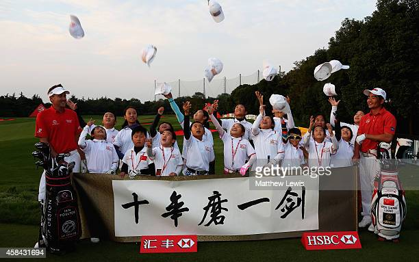 Ian Poulter and Liang WenChong pictured with local children during a CGAHSBC Junior Program Clinic ahead of the WGC HSBC Champions at the Sheshan...