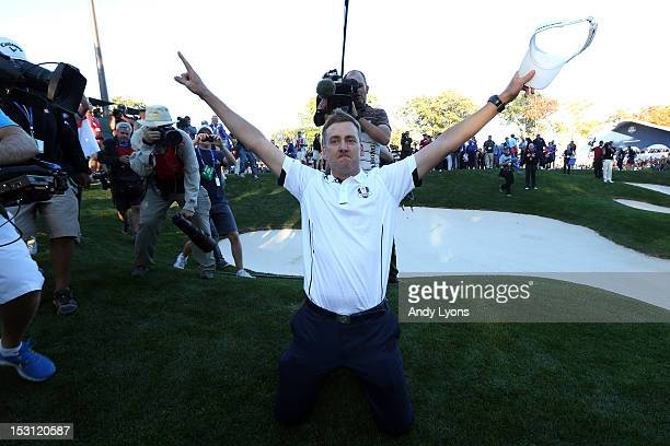 Ian Poulter celebrates after Europe defeated the USA 145 to 135 to retain the Ryder Cup during the Singles Matches for The 39th Ryder Cup at Medinah...