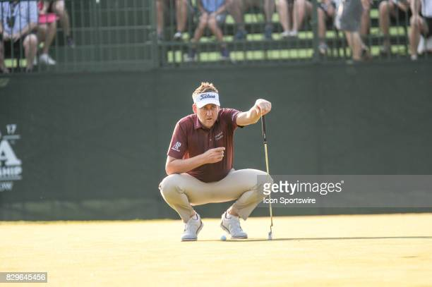 Ian Poulter eyes his putt on the 10th green during 1st round action at the PGA Championship at the Quail Hollow Club on August 10 2017 in Charlotte NC