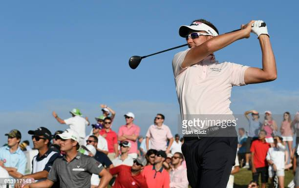 Ian Poulter hits a tee shot on 18during the final round of THE PLAYERS Championship on THE PLAYERS Stadium Course at TPC Sawgrass on May 14 in Ponte...