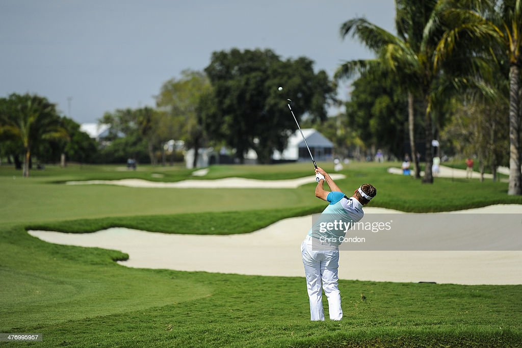 Ian Poulter hits from the rough on the 10th hole during the first round of the World Golf Championships-Cadillac Championship at Blue Monster, Trump National Doral, on March 6, 2014 in Doral, Florida.