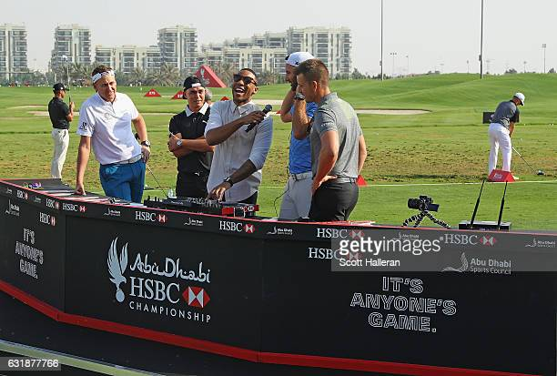 Ian Poulter of Engand Rickie Fowler of the USA DJ Reggie Yates Dustin Johnson of the USA and Henrik Stenson of Sweden during a photocall on the...