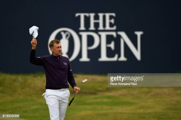 Ian Poulter of England acknowledges the appluase on the 18th hole during the first round of the 146th Open Championship at Royal Birkdale on July 20...