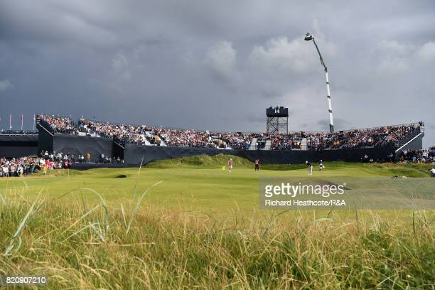 Ian Poulter of England and Brooks Koepka of the United States on the 14th green during the third round of the 146th Open Championship at Royal...