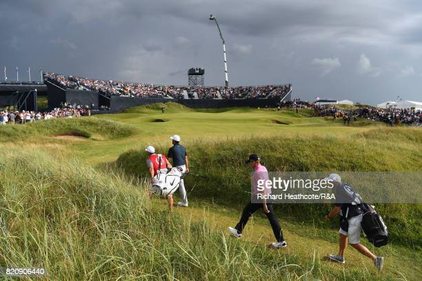 Ian Poulter of England and Brooks Koepka of the United States walk to the 14th green during the third round of the 146th Open Championship at Royal...