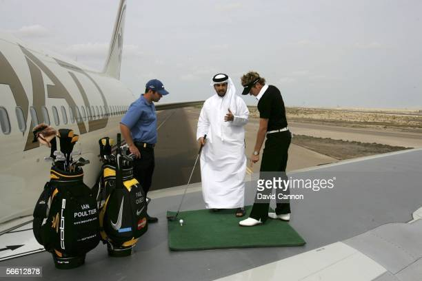 Ian Poulter of England and Paul Casey of England give an impromptu golf lesson to Etihad passenger Khalie Al Shamsi of the UAE as they signal takeoff...