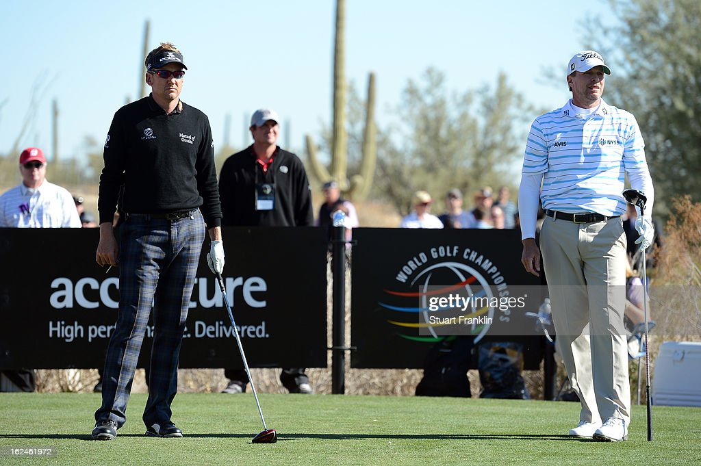 Ian Poulter of England and Steve Stricker hits look on from the 11th hole tee box during the quarterfinal round of the World Golf Championships - Accenture Match Play at the Golf Club at Dove Mountain on February 23, 2013 in Marana, Arizona.