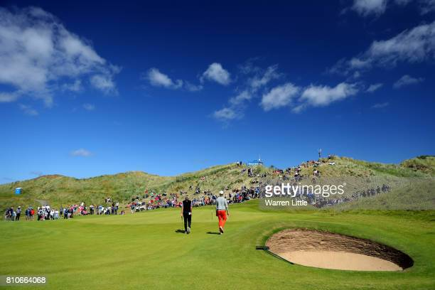 Ian Poulter of England and Thomas Detry of Belgium walk to the 3rd green during day three of the Dubai Duty Free Irish Open at Portstewart Golf Club...