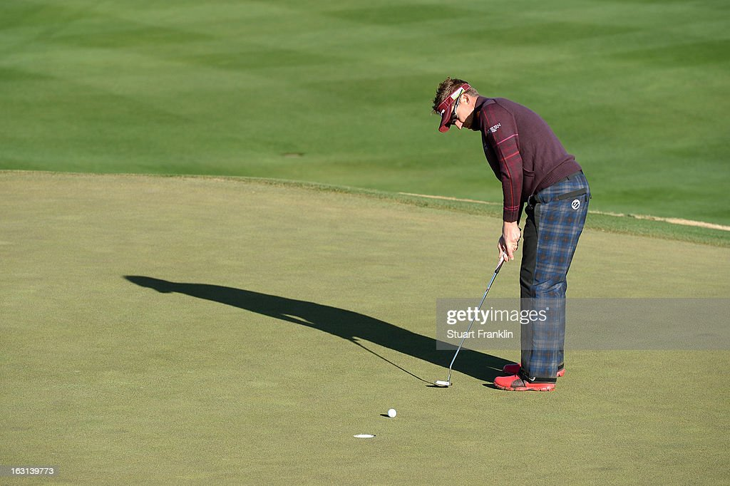 Ian Poulter of England attempts a putt during the semifinal round of the World Golf Championships - Accenture Match Play at the Golf Club at Dove Mountain on February 24, 2013 in Marana, Arizona.
