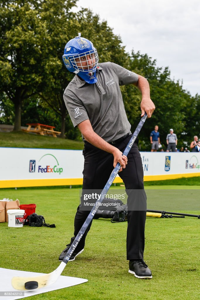 Ian Poulter of England attempts a shot in hockey during the championship pro-am of the RBC Canadian Open at Glen Abbey Golf Course on July 26, 2017 in Oakville, Ontario, Canada.