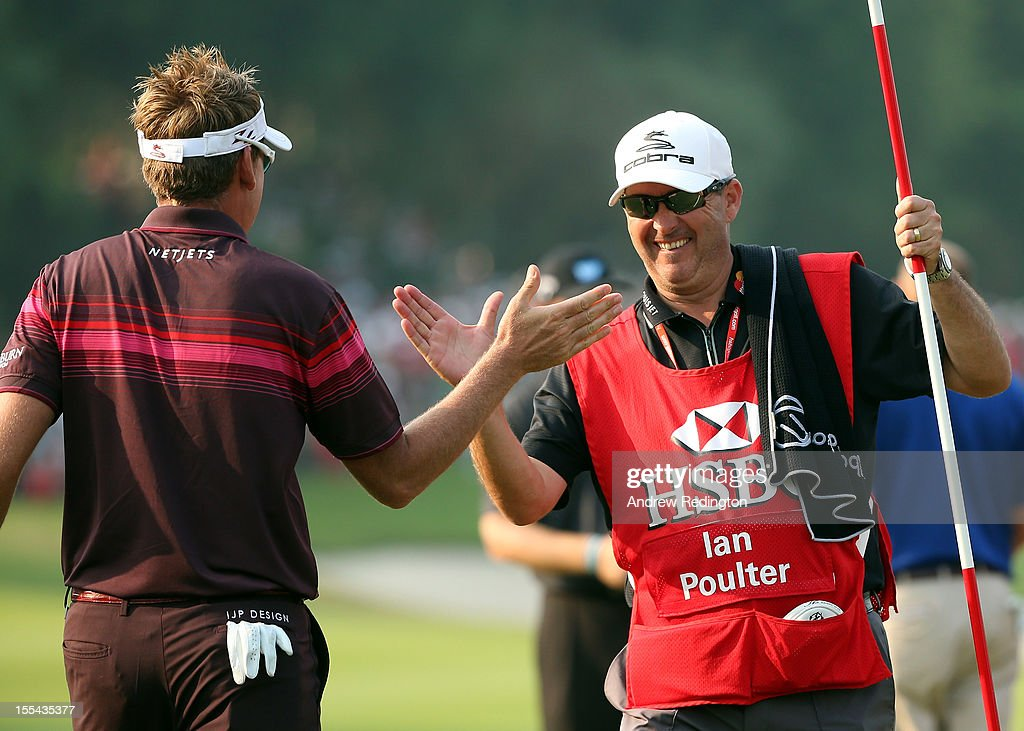 Ian Poulter of England celebrates with his caddie Terry Mundy on the 18th green after winning the WGC HSBC Champions at the Mission Hills Resort on November 4, 2012 in Shenzhen, China.