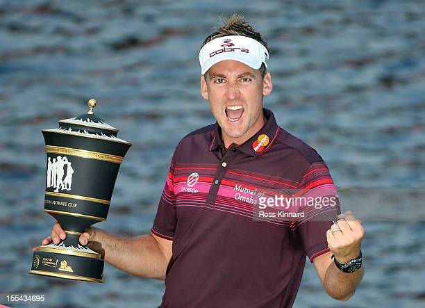 Ian Poulter of England celebrates with the champions trophy after winning the WGC HSBC Champions during the final round at the Mission Hills Resort...