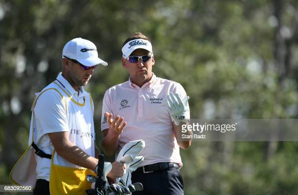 Ian Poulter of England discusses his shot during the final round of THE PLAYERS Championship on THE PLAYERS Stadium Course at TPC Sawgrass on May 14...