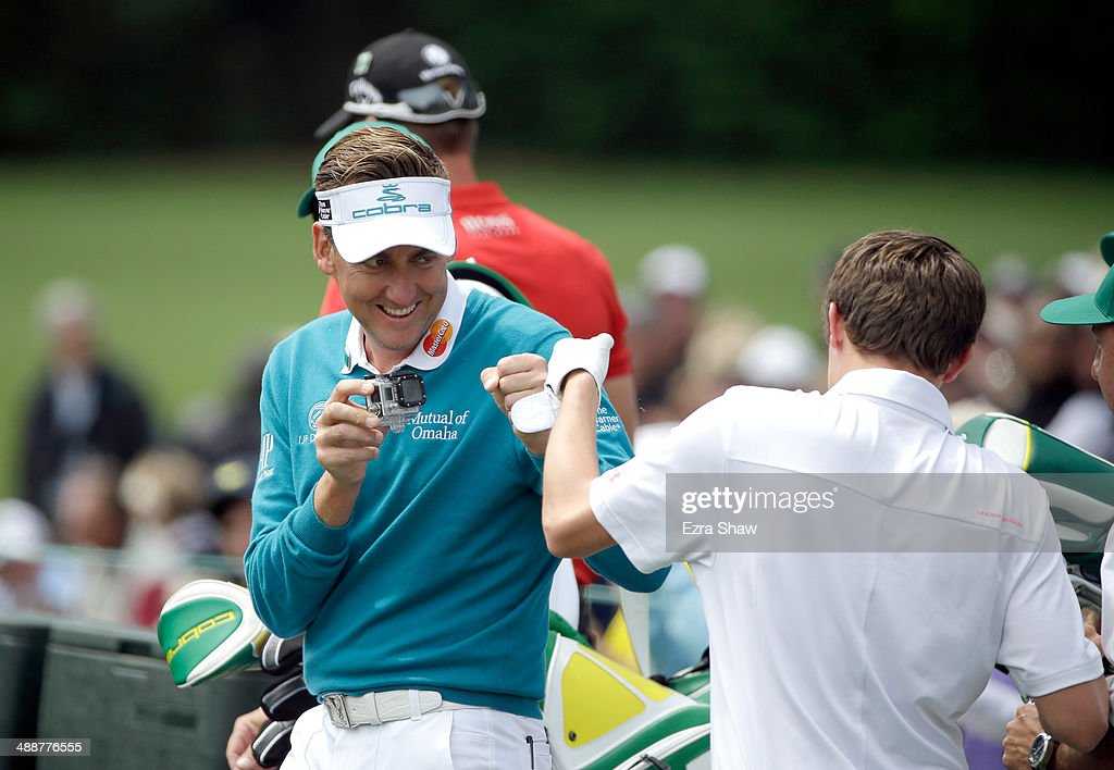 Ian Poulter of England first pumps with Matthew Fitzpatrick of England after Fitzpatrick teed off on the 12th hole during a practice round at Augusta National Golf Club on April 8, 2014 in Augusta, Georgia.