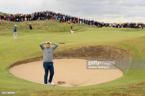 Ian Poulter of England gestures after his third shot from a bunker on the 8th hole during the second round of the 146th Open Championship at Royal...
