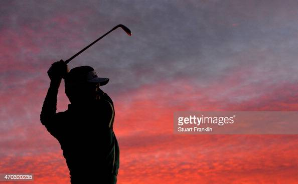 Ian Poulter of England hits a practice shot prior to the first round of the World Golf Championships Accenture Match Play Championship at The Golf...