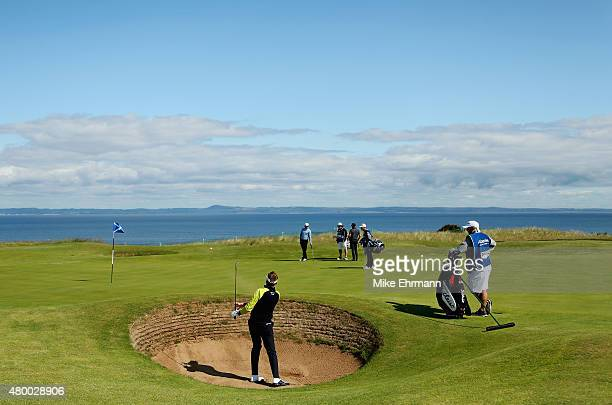 Ian Poulter of England hits a shot from a greenside bunker on the eighth hole during the first round of the Aberdeen Asset Management Scottish Open...